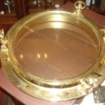 polished brass lacquer | ship porthole | after