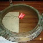 polished brass lacquer | ship porthole | before